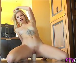 Inked flexible whore does the splits straight onto a big dildo